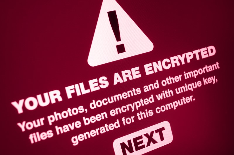 Pop up stating Your Files Are Encrypted. Hackers will encrypt your files with Ransomware and charge you to buy an encryption key to restore access to your data.